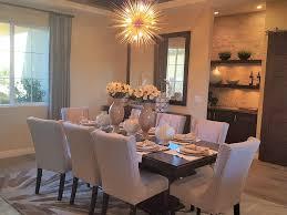 beautifully lit dining room with chandelier – rensenhouseoflights.com