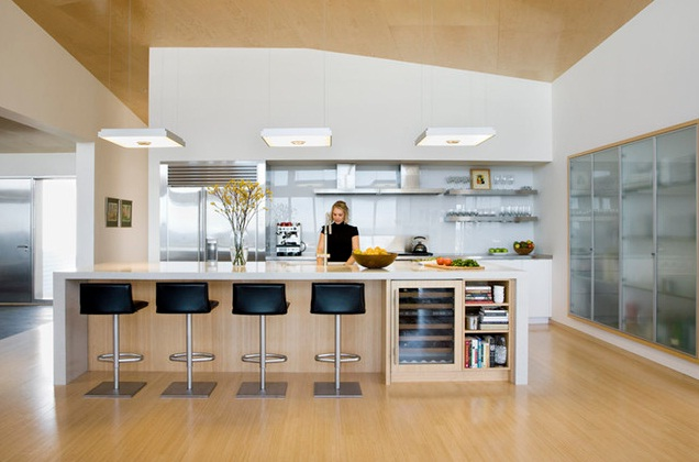 kitchen lighting tips. View Larger Image Woman Standing In A Modern Kitchen Lighting Tips